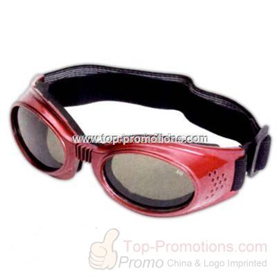 Kid is s rubberized goggles with red frames