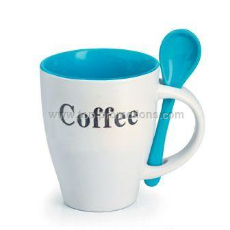 Coffee mug and spoon